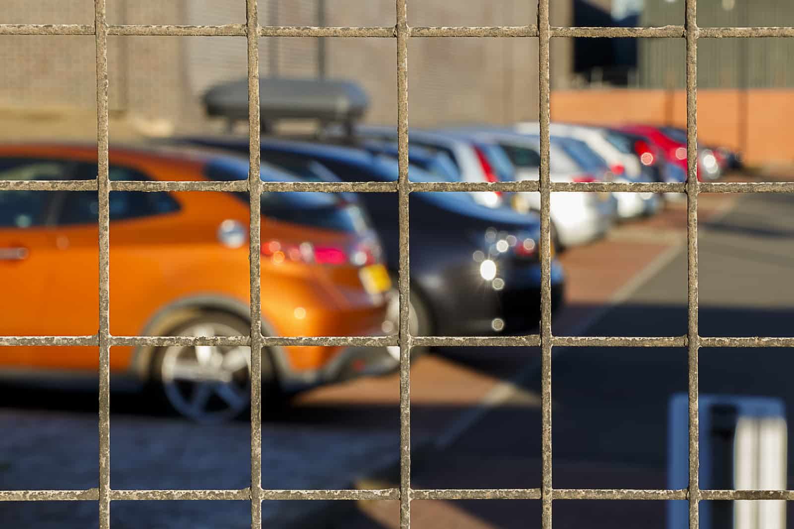 A line of cars behind fence from being impounded after a dui arrest