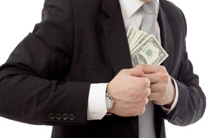 Man putting cash in suitcoat showing white collar crime in Utah