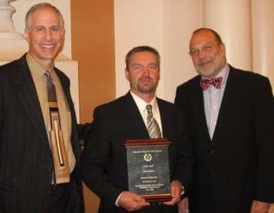 Attorney Jason Schatz receiving award from national dui college