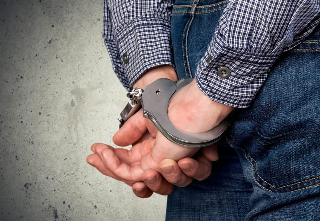 Handcuffed man arrested for fleeing an officer