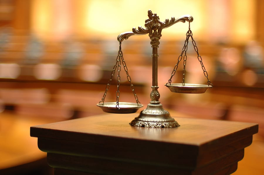 Scales symbolizing justice with a private criminal defense attorney