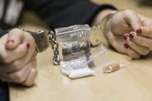 person arrested for breaking drug possession laws