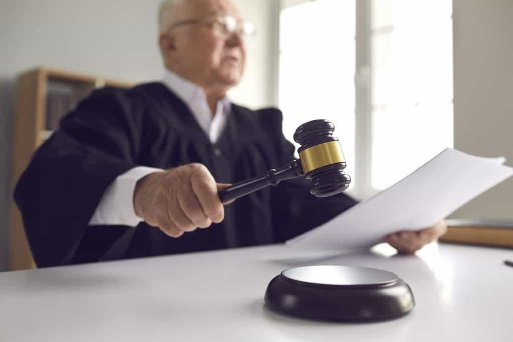 judge holding gavel stating requirements in Utah restraining order