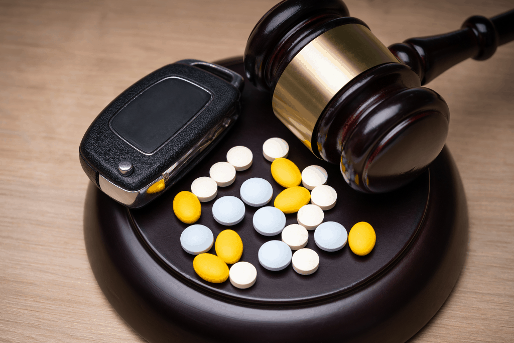 pills and gavel with car key for metabolite DUI laws in Utah